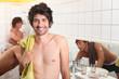 trio of male flatmates in bathroom