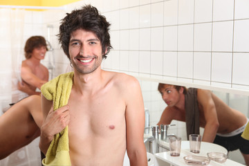 trio of male flatmates in bathroom