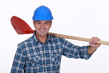 Builder resting shovel on shoulder