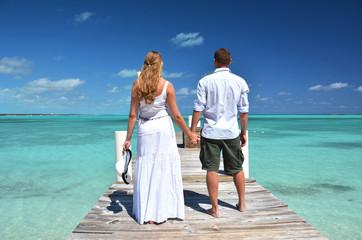 A couple on the wooden jetty. Exuma, Bahamas
