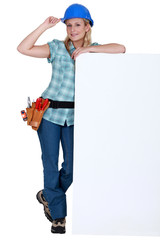 Female builder with a blank board