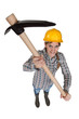 Woman holding pick axe