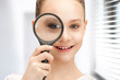 teenage girl with magnifying glass