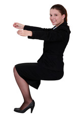 Businesswoman holding an invisible object