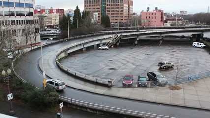 Car traffic on circle on ramp for downtown highway