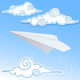 Paper airplane in the sky with paper decorative clouds