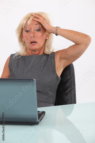 Shocked blond businesswoman