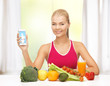 woman with fruits, vegetables and tablet pc