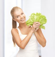 woman holding lettuce