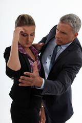 young woman having migraine comforted by mature gentleman