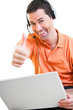 Happy work at home male working on laptop smiling