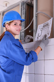 Female electrician looking at a diagram