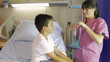 Female Doctor Examining Boy On Hospital Bed