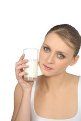 blonde woman drinking milk