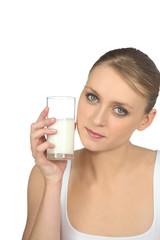 blonde woman drinking milk