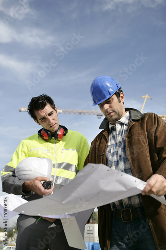 Construction workers looking at a blueprint