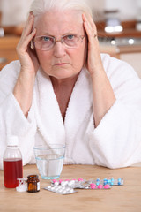 Bitter woman in front of her medication