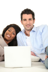 Couple at home with a laptop