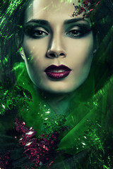 passionate woman in hood with green gemstones