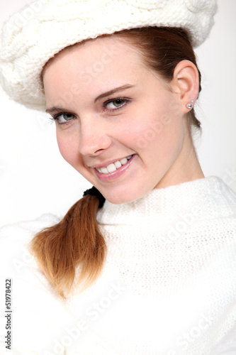 portrait of delightful woman with woolen cap and jumper