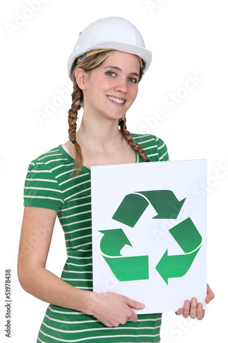 Woman holding a recycling label