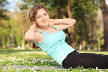 Young female exercising in a park