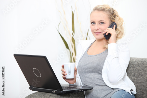Woman with computer and coffee cup