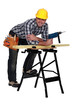Carpenter with drill casually leaning on work bench