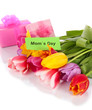 Beautiful tulips in bouquet with gifts and note isolated