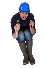Handyman holding chisel and hammer