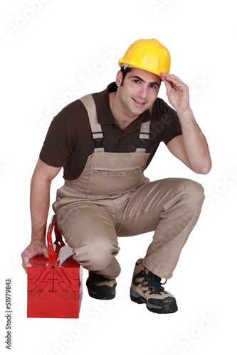 Construction worker posing with his toolbox