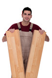 a carpenter showing floorboards