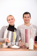 Couple baking in the kitchen