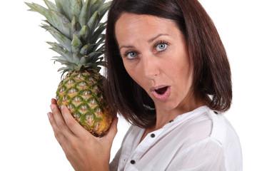 Woman holding pineapple
