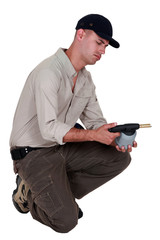 craftsman holding a welding torch