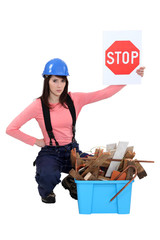 Female construction worker campaigning against littering.