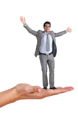Businessman standing on a woman's hand