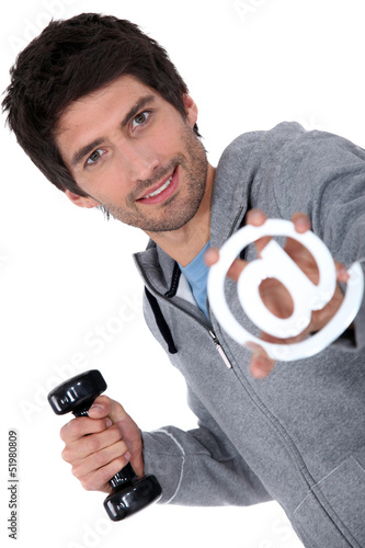Man holding barbell and at sign
