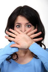 Woman hiding her mouth