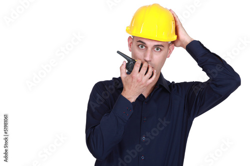 Confused architect holding radio