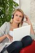 Blond teen wearing headphones