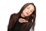 Cute young woman blowing a kiss