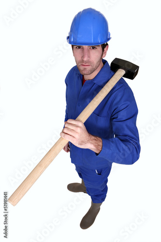 Craftsman with hammer on shoulder