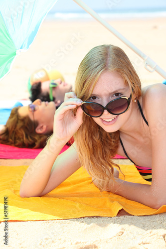 Teens tanning on the beach