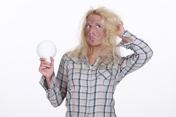 Young woman holding light-bulb