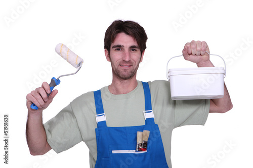 Decorator with paint and a roller