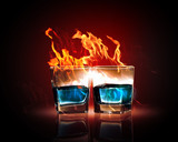 Two glasses of burning emerald absinthe
