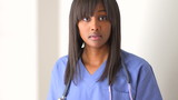 Black woman doctor looking at camera