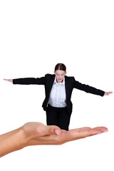 Businesswoman balancing in a hand