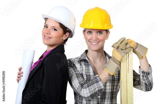 female architect stood with female carpenter
